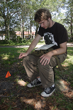 myrmecologist Fred Larabee monitors the activity of a trap-jaw ant nest.  Note the ideal field shoes...