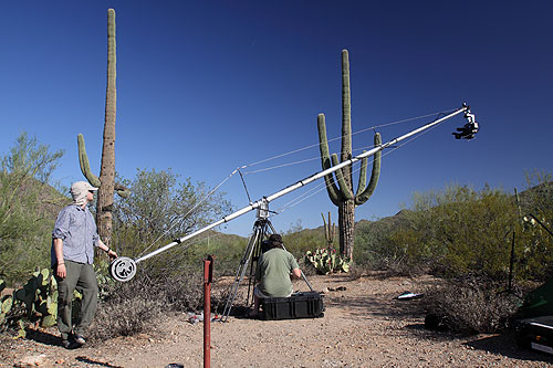 Swooping down from the top of a saguaro down to the desert floor: Howard moves the crane while Martin drives the camera.