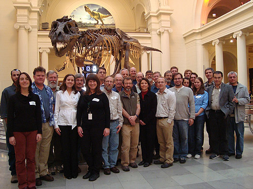 An oversize tyrranosaur photo-bombs the Global Ant Project group portrait at the Chicago Field Museum